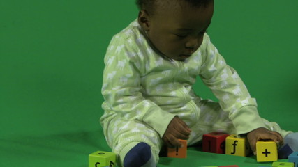 MS PAN OF A BABY PLAYING WITH BUILDING BLOCKS