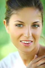 Beautiful young woman on a green background