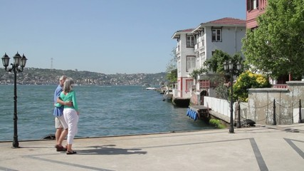 Couple walking on Promenade at the Bosphorus river Turkey, Istanbul