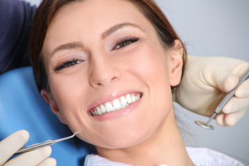 examination of the teeth in the office of the dentist