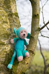 Selfmade stuffed monkey in tree