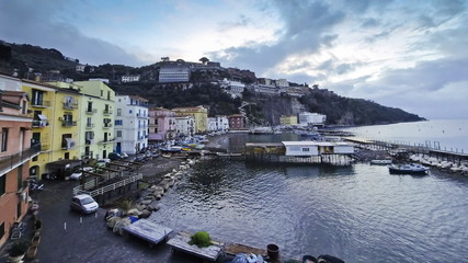 Evening view of small harbour in Sorrento city, Italy