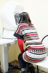 Woman patient checks vision