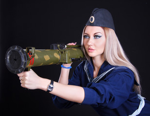 Woman in a marine uniform with a grenade launcher