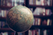 Leinwanddruck Bild - Globe in a library