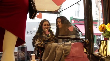 MS, Females looking at window display of shop