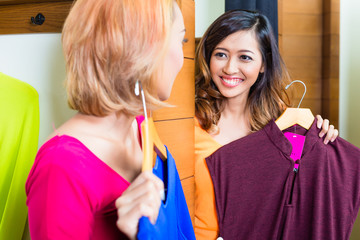 Asian best friends shopping in fashion store
