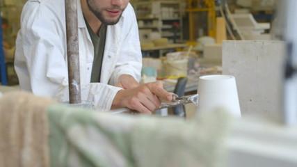 Man making ceramic on pottery wheel