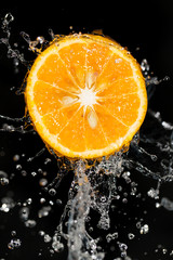 orange in water on a black background