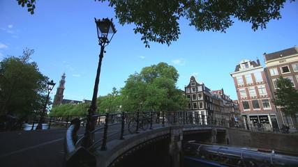 Pedestrian near bridge across canal, Amsterdam, Netherlands