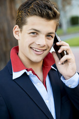 Handsome teen with phone