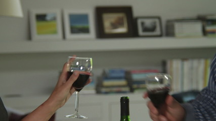 Close up  off couple toasting with wine glasses