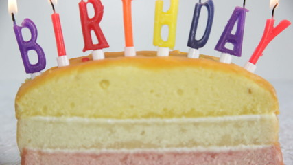 PAN, CU, burning birthday candles on cake