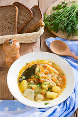 Traditional Russian cabbage soup with proso millet and potato