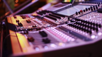 Cool shot of Digital Audio Console by stage during performance