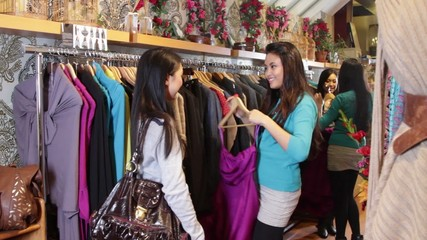 MS, Females looking in clothes shop at clothes