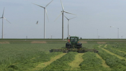 LS ZI OF A COMBINE HARVESTER AND WIND TURBINES