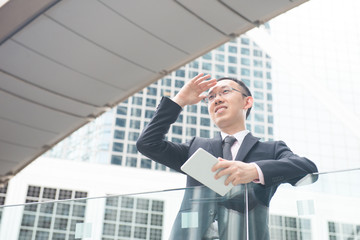 asian businessman with tablet computer on  hong kong central dis