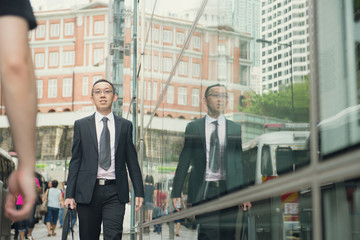 hong kong businessman in busy central district street