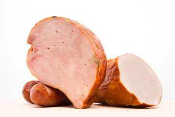 ham and sausage on a wooden board