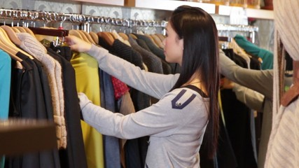 MS, Female looking in clothes shop at dresses