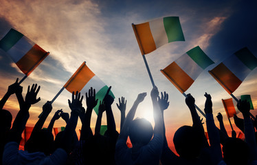 Silhouettes People Holding Flag Ireland Concept