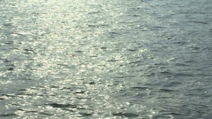 Shot of calm sea sun reflecting