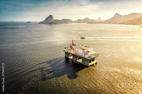 Oil drilling rig against panorama of Rio De Janeiro, Brazil - 79604733