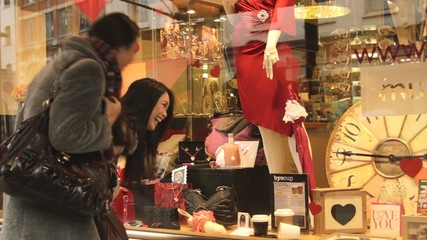 MS, Females looking at window display of shop