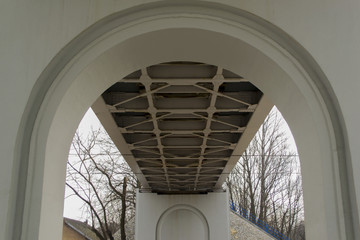 Metal bridge with arches - view from below