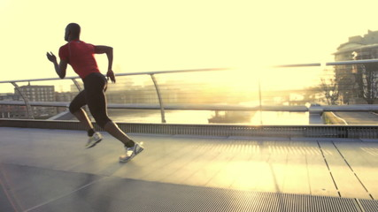 Male starting positions on millenium bridge London, UK and sprint over bridge