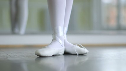CU A Young Ballerina eases into her soft top Ballet Shoes