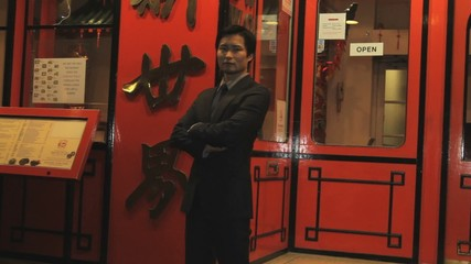 Portrait of owner of Chinese restaurant