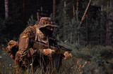 Army soldier preparing to attack/protect. Soldiers in ambush. poster