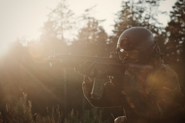 A soldier of German special forces aiming