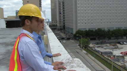 View of construction workers inspecting a site
