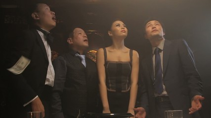 Group  looking up at money falling down in slow motion