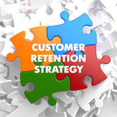Customer Retention Strategy Texts on Puzzle Pieces