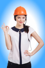 Smiling cheerful young support phone operator in builder helmet