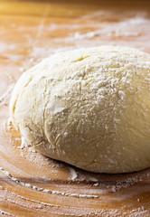 dough and flour on the table