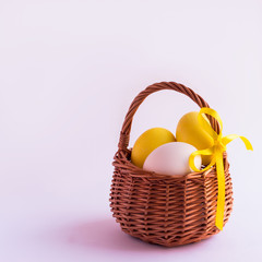 Easter eggs in the basket on a white background. Selective focus