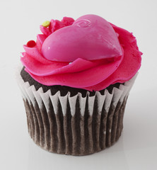 Pink cupcake with a heart