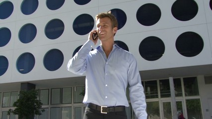 Male walking into frame picking up phone