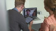 Business colleagues video chatting