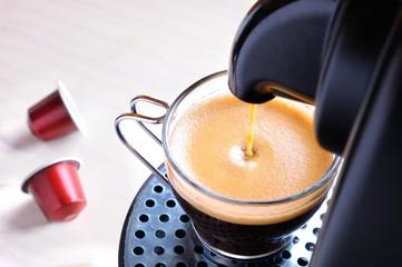 machine serving espresso coffee top view