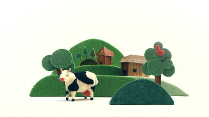 Farm with cow appears on white background