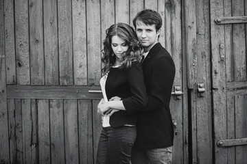 black and white photo of a young couple outdoors