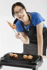 Cute girl showing Grilled Shrimp