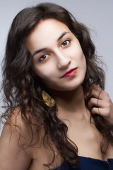 Portrait of a Young Beautiful Woman with Long Brown Hair