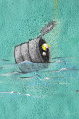 Drawing  of tin with two eyes into water